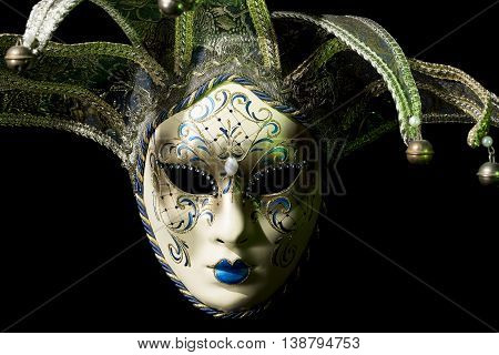 Beautiful venezian souvenir mask with jingles on black background poster