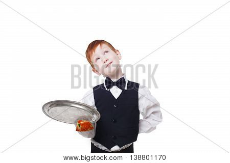 Clumsy little waiter drops tray with small pizza piece while dreaming. Food falling down. Redhead child boy in suit shows inattentive waiter failure at white background