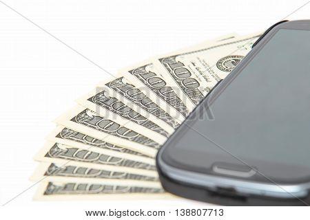 Close up on dollar bills, Smartphone lying on the United States dollars,