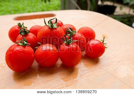 Cherry Tomato fresh group on wooden chopping board. lycopene and antioxidant in fruit nutrition good for health and skin
