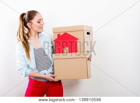 Woman Moving Into Home With Boxes And Paper House.