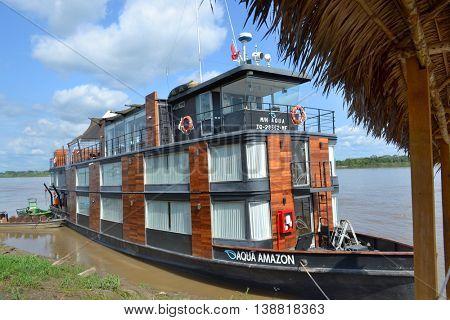 NAUTA, PERU - OCTOBER 17, 2015: The Aqua Amazon River Cruise Ship. The luxury ship is shown at it home port in Nauta ready to take on passengers.