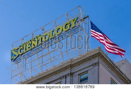 HOLLYWOOD CA/USA - JULY 9 2016: Church of Scientology sign and logo on Hollywood Boulevard.