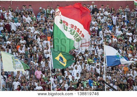 Rio de Janeiro Brazil - April 10 2016: Fan flag player in match between Fluminense and Cruzeiro by the Brazilian championship in the Giulite Coutinho Stadium