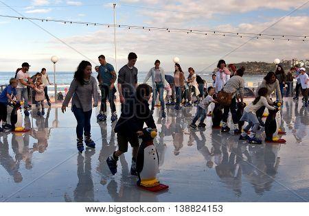 Sydney Australia - Jul 17 2016.People are ice skating on Bondi ice rink. Australia's only beachside ice rink is on Bondi beach.