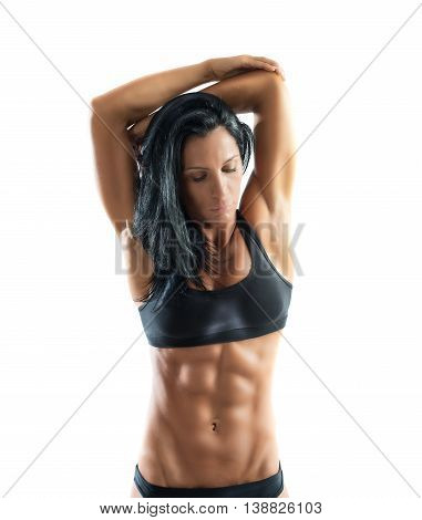 Muscular woman in a pose of stretching