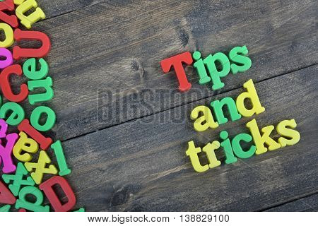Tips and tricks word on wooden table