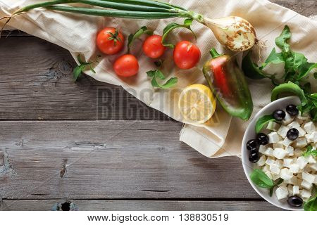 Ingredients for cooking Greek salad. With space for text