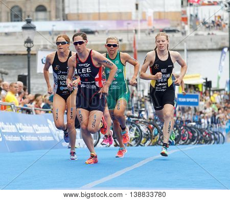 STOCKHOLM - JUL 02 2016: India Lee (GBR) and group of colorful triathletes running in the transition zone in the Women's ITU World Triathlon series event July 02 2016 in Stockholm Sweden