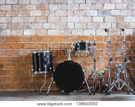 Drum Music instrument Sound equipment on Brick wall background