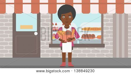 An african-american young female baker holding basket with bakery products. Female baker standing in front of bakery. Baker with bowl full of bread. Vector flat design illustration. Horizontal layout.