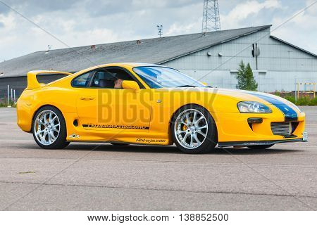 Yellow Sporty Toyota Supra A80