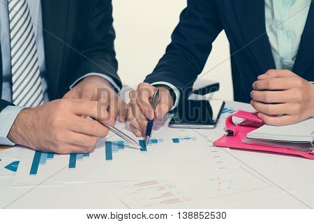 Business people meeting to discuss on white