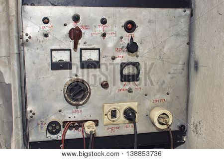 Details of a control desk, old and dirty, part of a machine. Vintage electrical panel