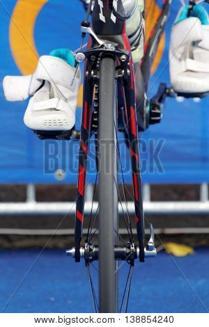STOCKHOLM - JUL 02 2016: Closeup of a cycle wheel and shoes in the Women's ITU World Triathlon series event July 02 2016 in Stockholm Sweden