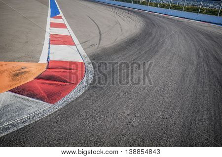 Texture of motor race asphalt and red white curb. Close up on F1 Grand Prix street circuit