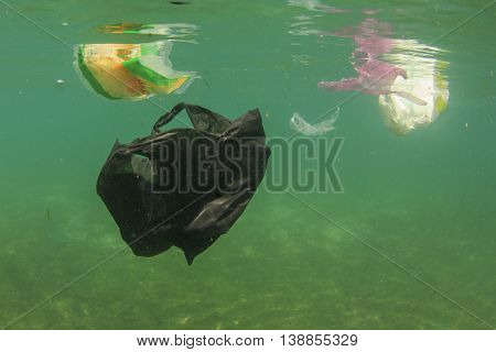 Plastic bags pollution damages ocean environment in sea