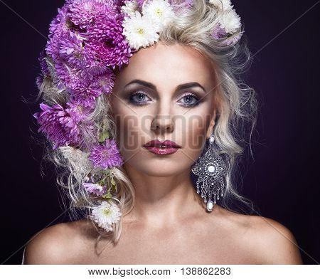 beauty foto of a woman with flowers in hair art fantasy portrait