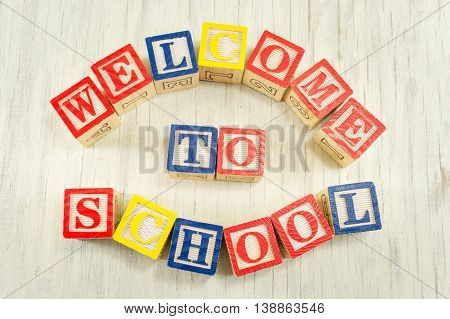Welcome To School Written In Wooden Cubicle Letters