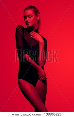 sexy girl in black lingerie on red background fashion