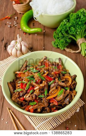 Stir fry pork sweet peppers onions and garlic. Asian cuisine