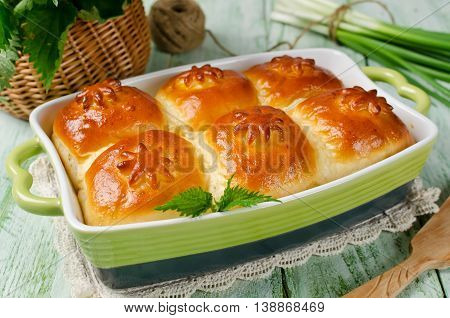 Yeast buns with a filling of cottage cheese and nettles. The filling of the nettle is rich in carotene and vitamin C