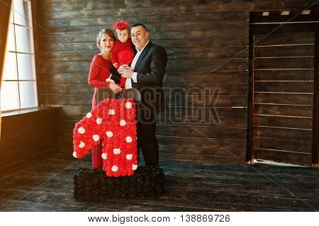 Happy Family And Daughter With 1 Year Anniversary Decor Handmade Number At Old Wooden House