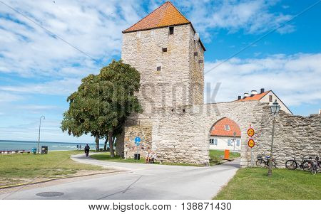 VISBY, SWEDEN - JULY 8, 2016: The medieval city wall in Visby. Visby is a historic Hanse town and a major tourist destination on Swedish Baltic sea island Gotland.