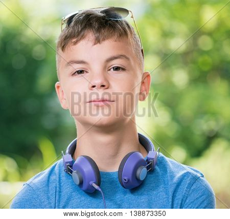 Portrait of a teen boy 12-14 year old with sunglasses