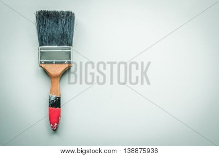Paint brush on paper background, still life.