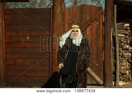 Bearded Man On Wooden Background In Golden Crown