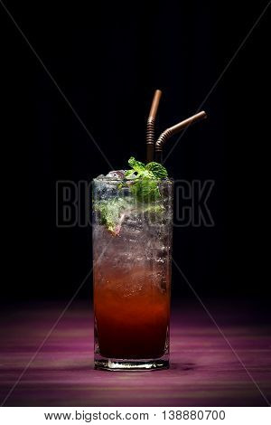 trendy modern strawberry mojito fusion cocktail in sophisticated lounge bar at night
