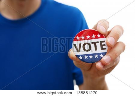 American votes concept. Man holding voting badge on white background