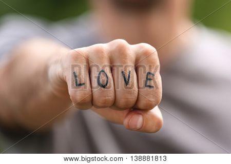 Man fist with fake tattoo
