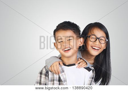 Portrait of young happy Asian brother and sister