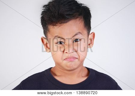 Portrait of young Asian boy getting angry and resentful
