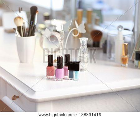 Nail polish set on light dressing table