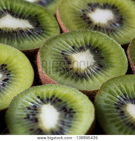 Closeup of kiwifruits. Kiwifruit (often shortened to kiwi) or Chinese gooseberry.