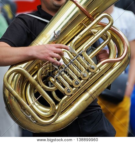 Musician Is Playing On The Tuba.