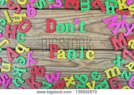 Don't Panic word on wooden table