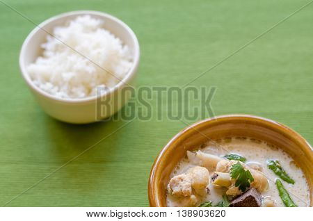 Thai Chicken Soup In Coconut Milk (tom Kha Gai) With Rice On Green Background, Thai Food.