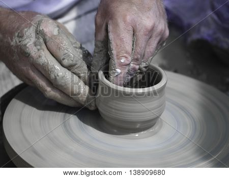 Artisan Hands Making Clay Pot