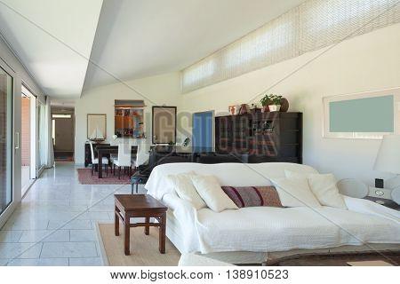 living room of a modern house, white divan, interior