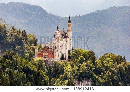 Castle Neuschwanstein in green forrest. Romantic in Germany
