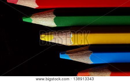 A set of colorful pencils ranged from long to short