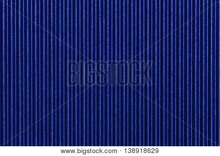 Texture corrugated blue paper. Striped corrugated background closeup