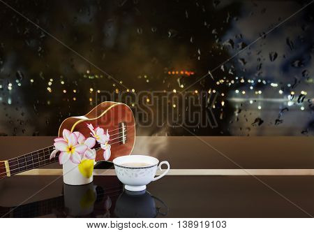 Cup Of Hot Tea Or Hot Drink With Flowers And Ukulele In Night Light