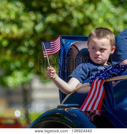 He Waves His Flag In The Car