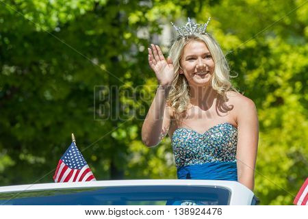 Woman Waves At The Parade