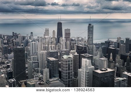 Chicago downtown cityscape with skyscrapers aerial or bird-eyes view cloudy day. Michigan lake on the background. Illinois USA. Vintage photo effect